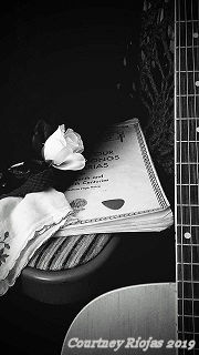 A beautiful picture of a guitar and a music book.